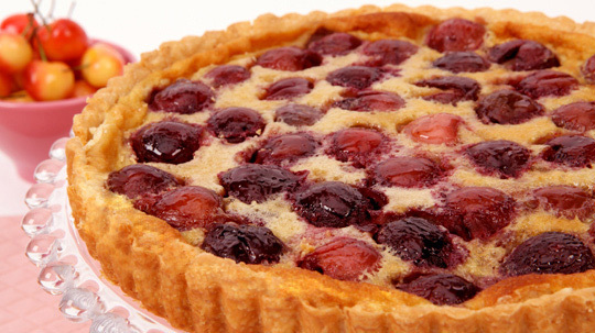 Sweet Cherry Custard Tart 	             cup all-purpose flour cup butter egg yolk tbsp granulated sugar salt cups pitted sweet cherries eggs cup whipping cream cup all-purpose flour cup granulated sugar tbsp grated lemon rind tbsp vanilla salt