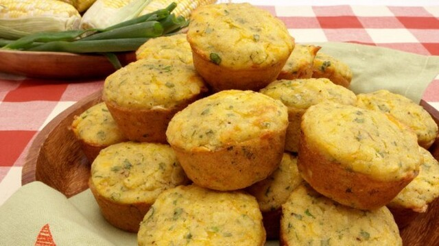 Corn Muffins with Green Onions 	             milk vinegar yellow cornmeal all-purpose flour baking soda salt pepper 14 oz can creamed corn vegetable oil eggs hot pepper sauce shredded Cheddar cheese frozen corn green onions minced fresh parsley