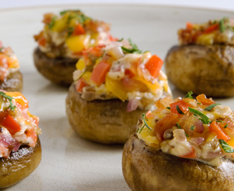 Stuffed Mushroom Caps 	             mushrooms vegetable oil pancetta or bacon finely chopped sweet red peppers finely diced red onions cloves garlic salt pepper goat cheese shredded old cheddar cheese chopped fresh parsley