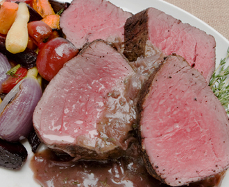 Beef Tenderloin with Cabernet Shallot Sauce 	             beef tenderloin premium oven roast black peppercorns sea salt olive oil butter sliced shallots granulated sugar cloves of garlic minced fresh thyme bay leaf beef stock dry red wine brandy cornstarch