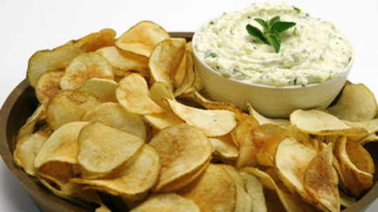 Saratoga Chips with Herbed Feta Dip 	             baking potatoes oil for deep-frying salt finely crumbled feta cheese each light sour cream and light mayonnaise minced fresh parsley minced fresh oregano small clove garlic hot pepper sauce