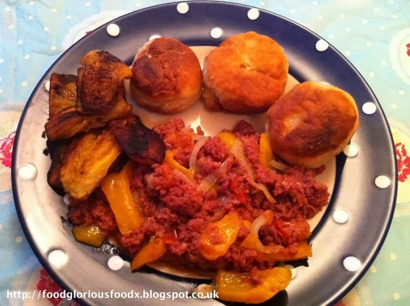 Cooked up corned beef, fried dumplings and fried plantains.