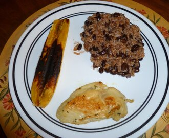 ROSEMARY AND GARLIC CHICKEN WITH RICE AND BEANS AND GRILL PLANTAIN