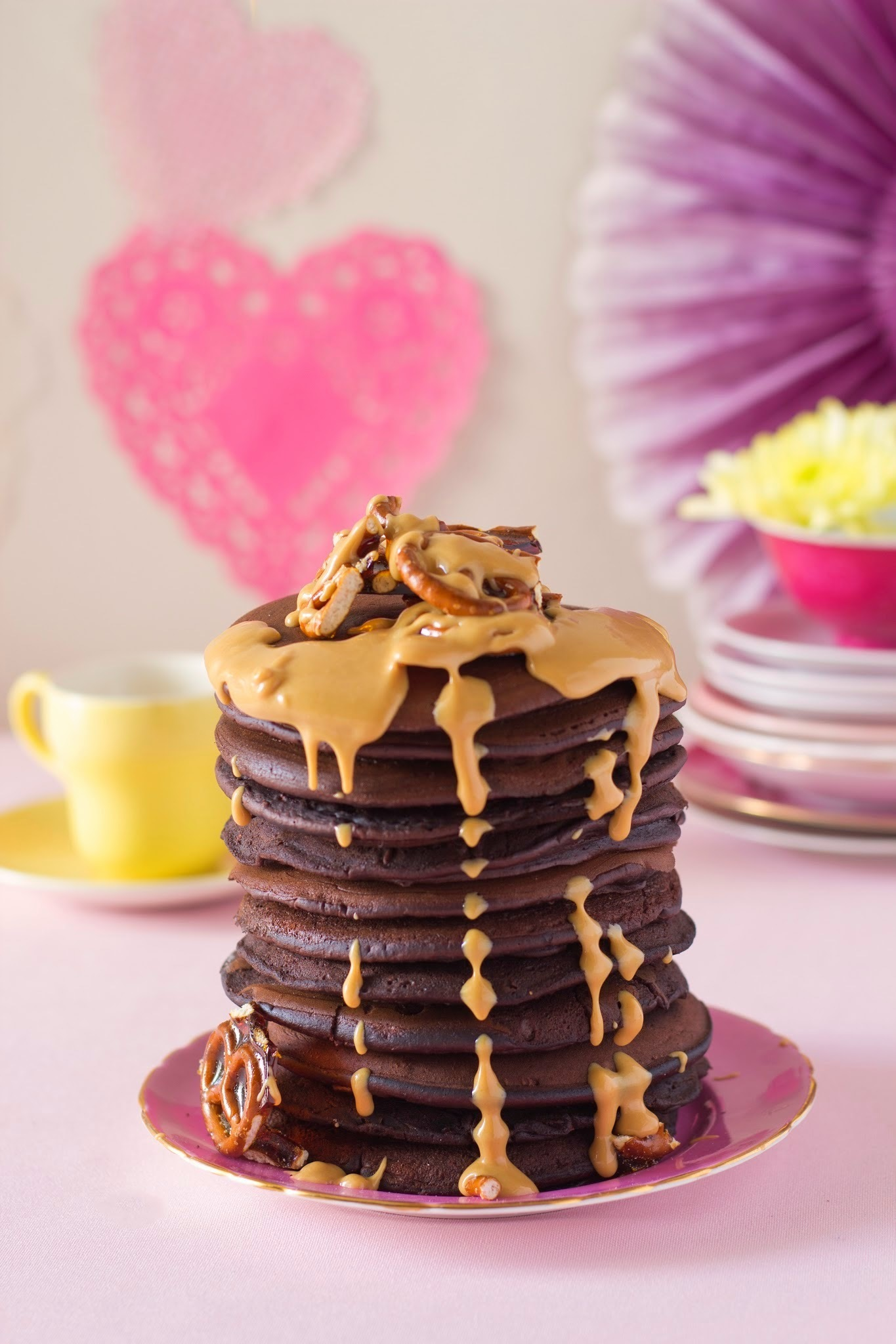 Chocolate brownie flapjack stack with pretzel brittle and peanut butter sauce