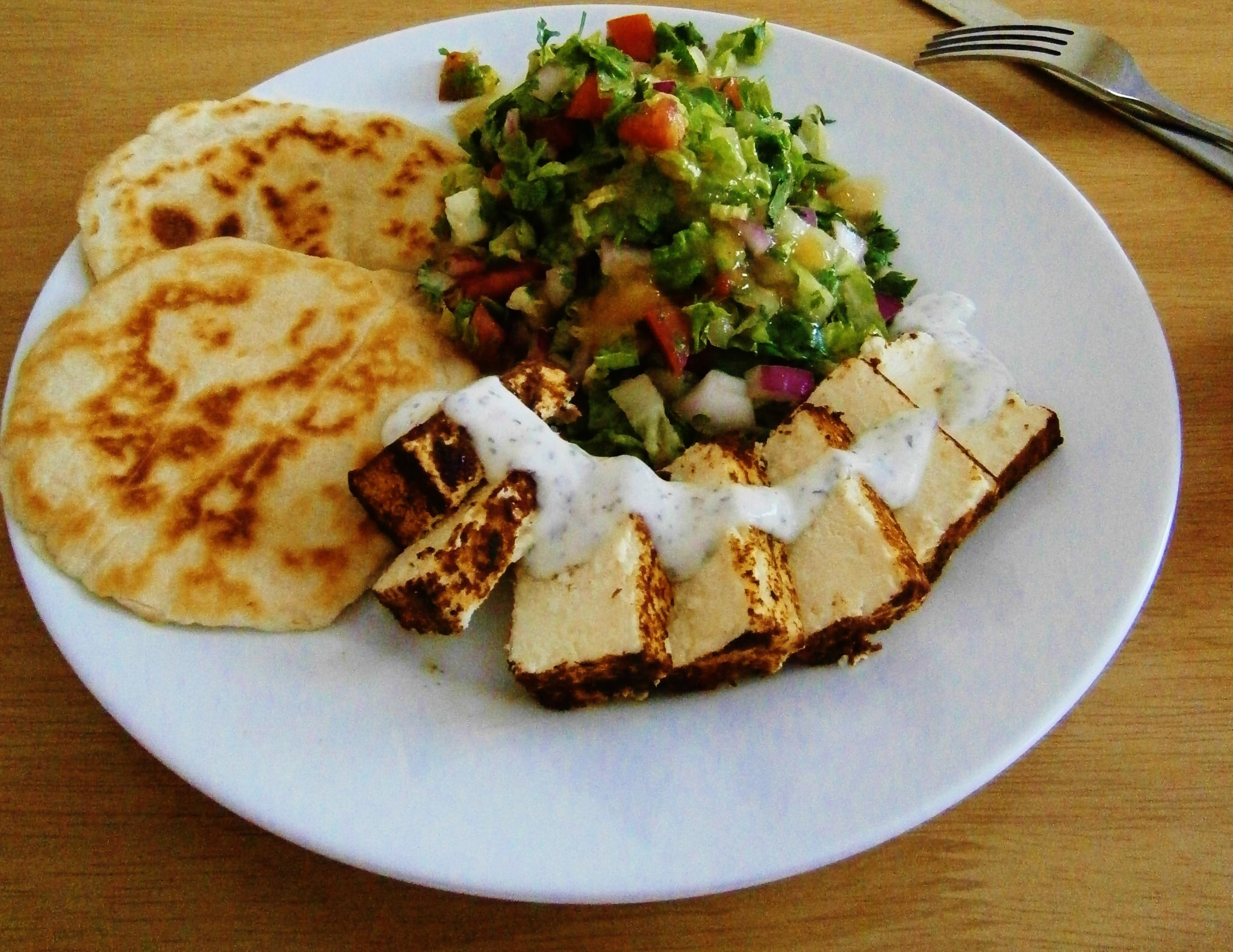 Marinated paneer with minted yoghurt served with an Indian style chopped salad and almond stuff roti