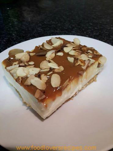 LEMON CHEESECAKE WITH CARAMEL AND ROASTED ALMOND FLAKES