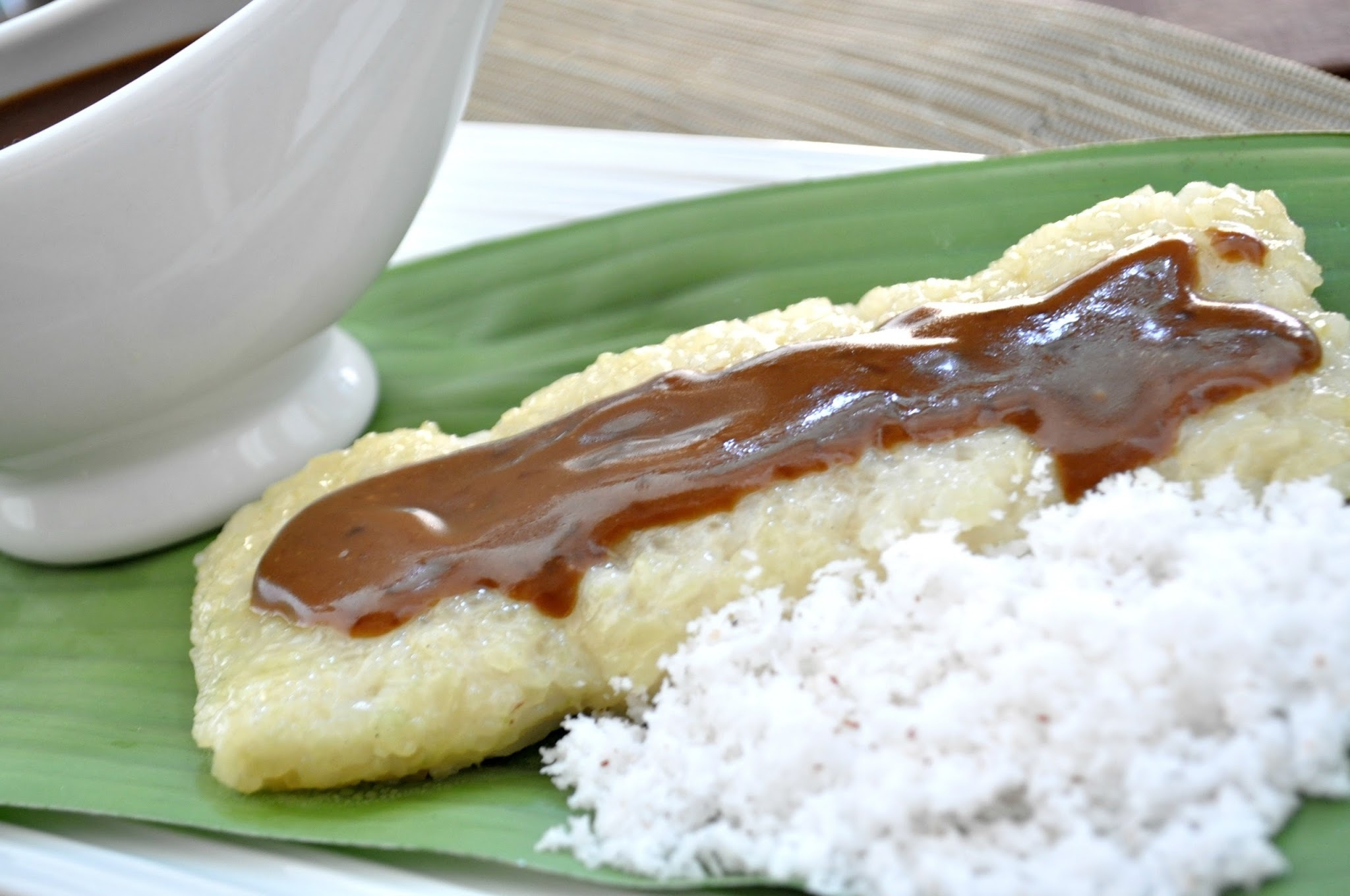 Suman sa Lihiya with Latik (Wrapped Rice Cake with Coco-Butter Syrup)