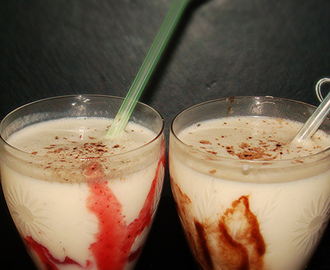 Banana milk shake with strawberry and chocolate syrup