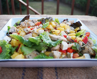 Chicken and pineapple salad with red pepper and baby greens