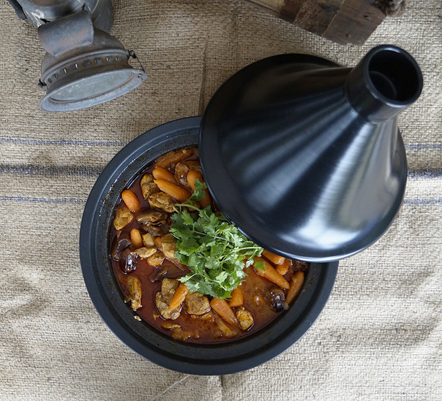 Red curry chicken tagine with orange juice and dates