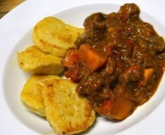 Slow-cooked beef stew with yellow sweet potatoes and German dumplings
