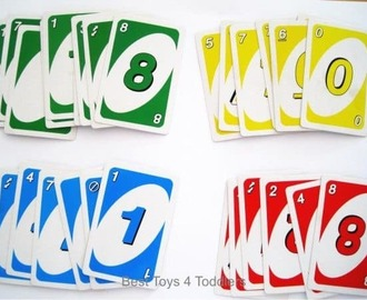 Number and color recognition practice with toddler using uno card game