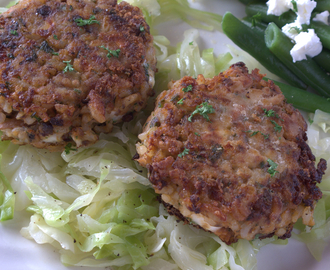 Creamy feta fish cakes on buttered cabbage