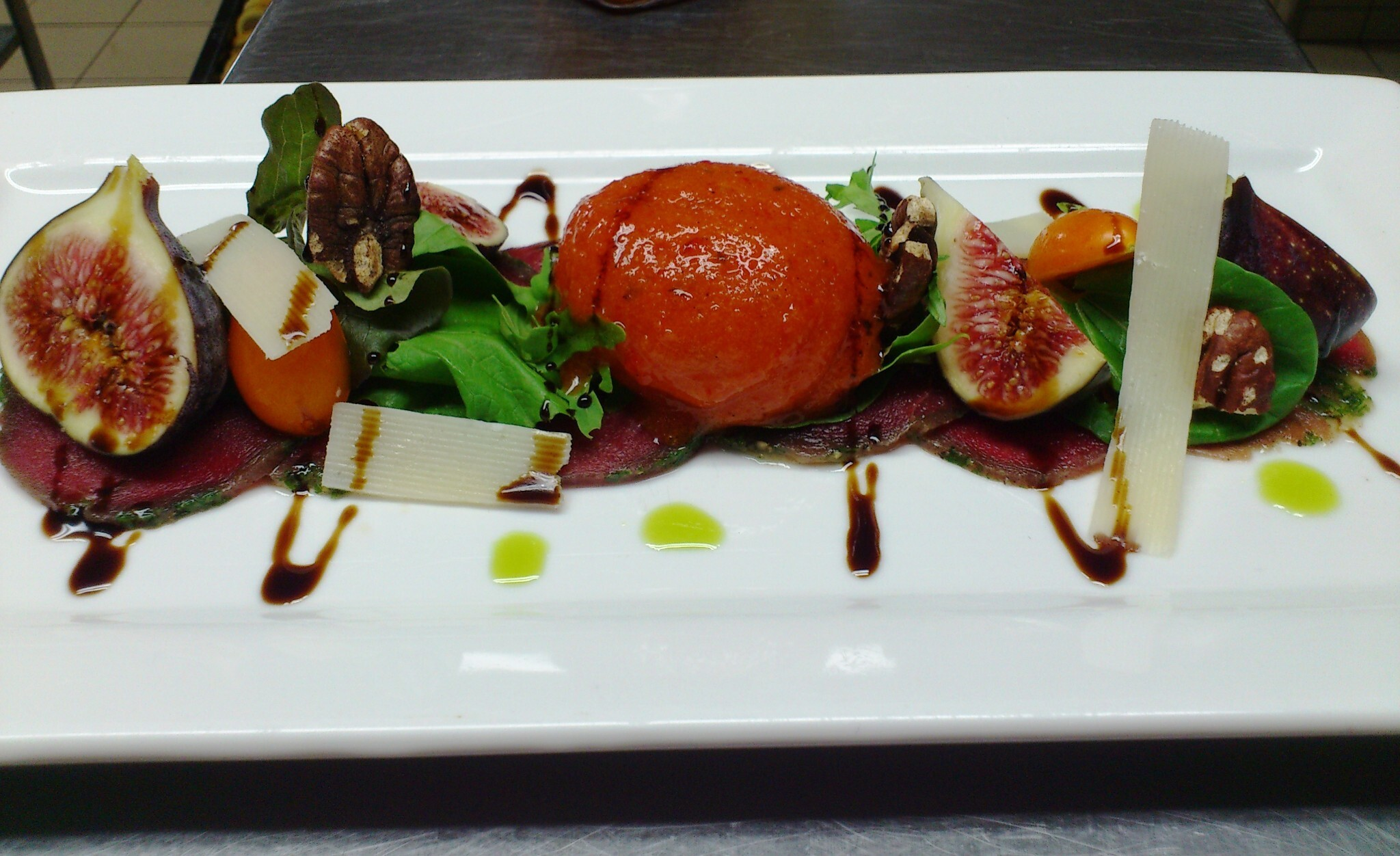 Beef Carpaccio with Roasted Red Pepper Sorbet, Fresh Figs, Pecan Nuts and Parmesan shavings