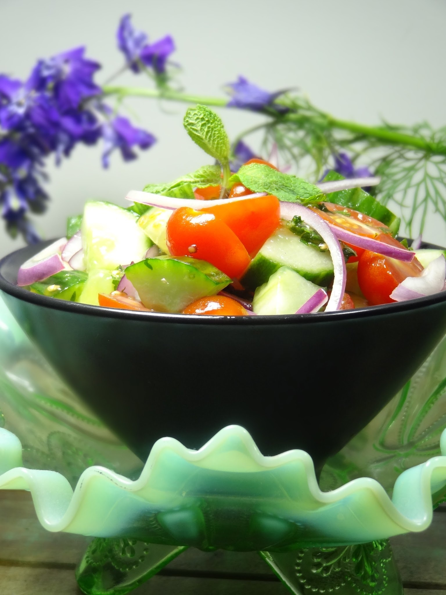 Cucumber and tomato salad with mint dressing