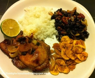 Sticky lime and chilli pork with rice & black beans & plantain chips.