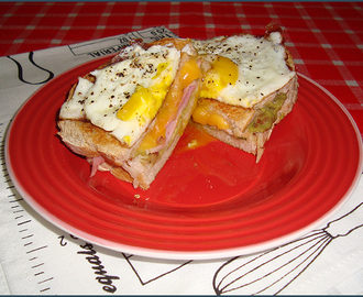 Grilled ham and cheese with guacamole and fried eggs