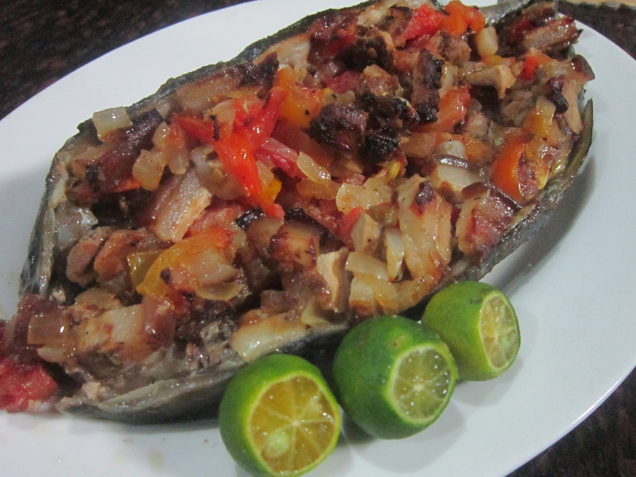 BROILED BANGUS STUFFED with PORK ADOBO, TOMATOES and ONIONS