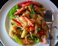 Stir fried spicy flat rice noodles with shrimp (Sen Yai phad kee mow koong)