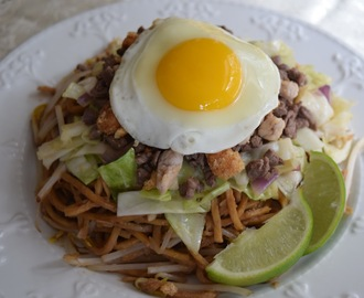 Pansit Batil Patung (Stir-Fried Noodles with Meat, Vegetables and Egg Toppings)