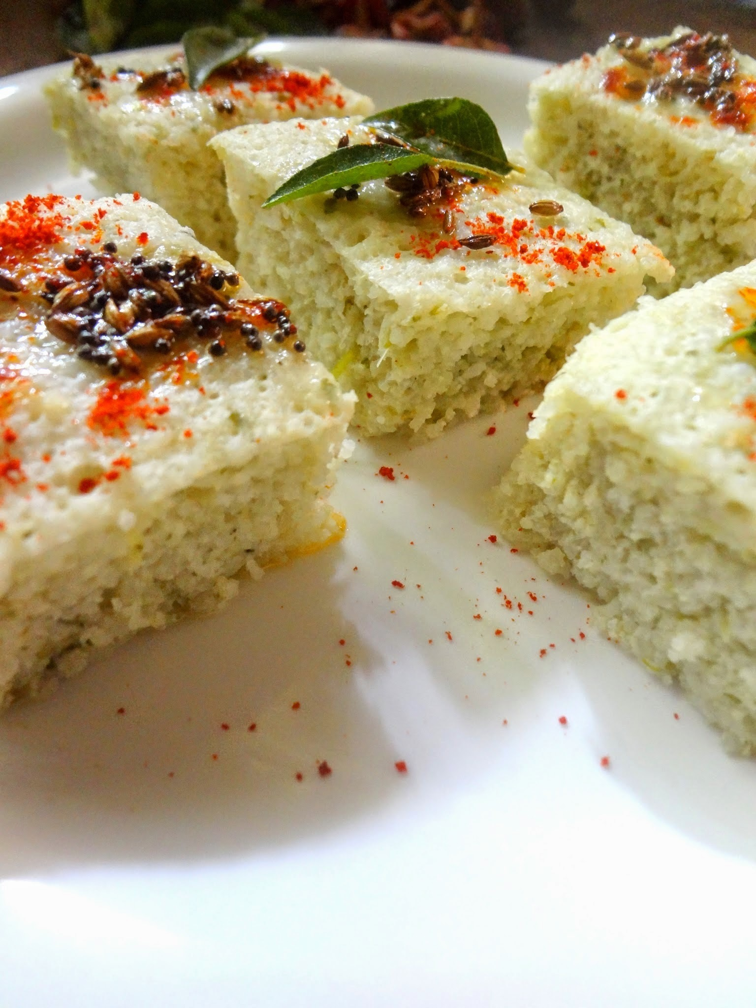 Khatta Dhoklas ( steamed lentils  and rice  savoury cakes)