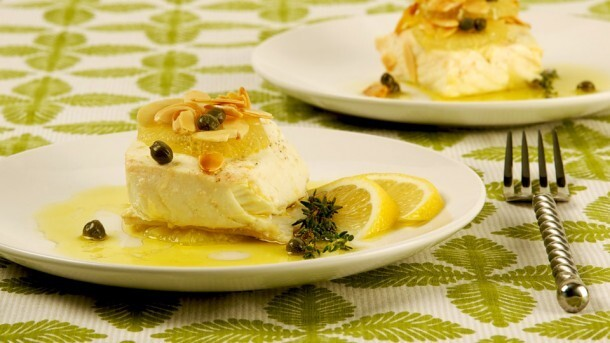 Oven-Poached Lemon-Oil Fish 	             lemons sprigs fresh thyme thick salt pepper toasted capers extra virgin olive oil