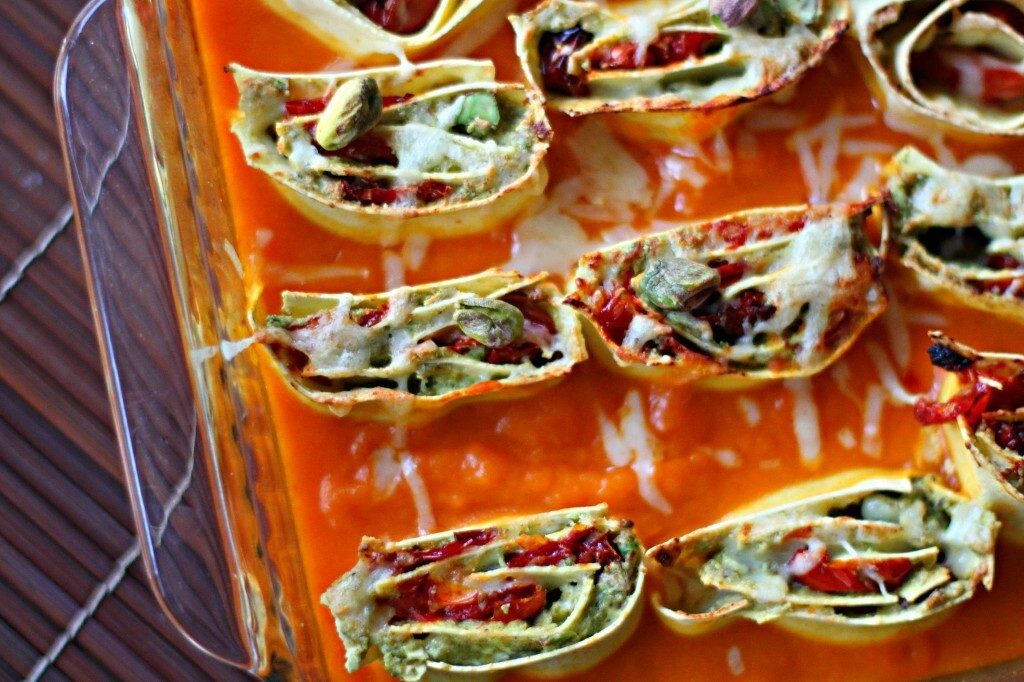 Slow roasted tomato and pistachio pasta rotolo in a spiced butternut squash sauce