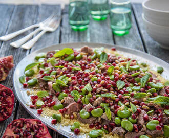 Lamb with Pomegranate, Mint and Broad Beans on a Bed of Couscous