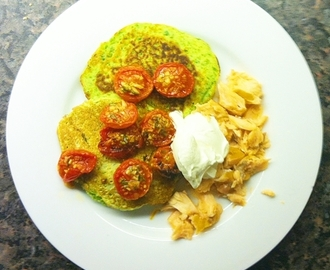 Pea fritters with roast tomatoes and hot smoked salmon