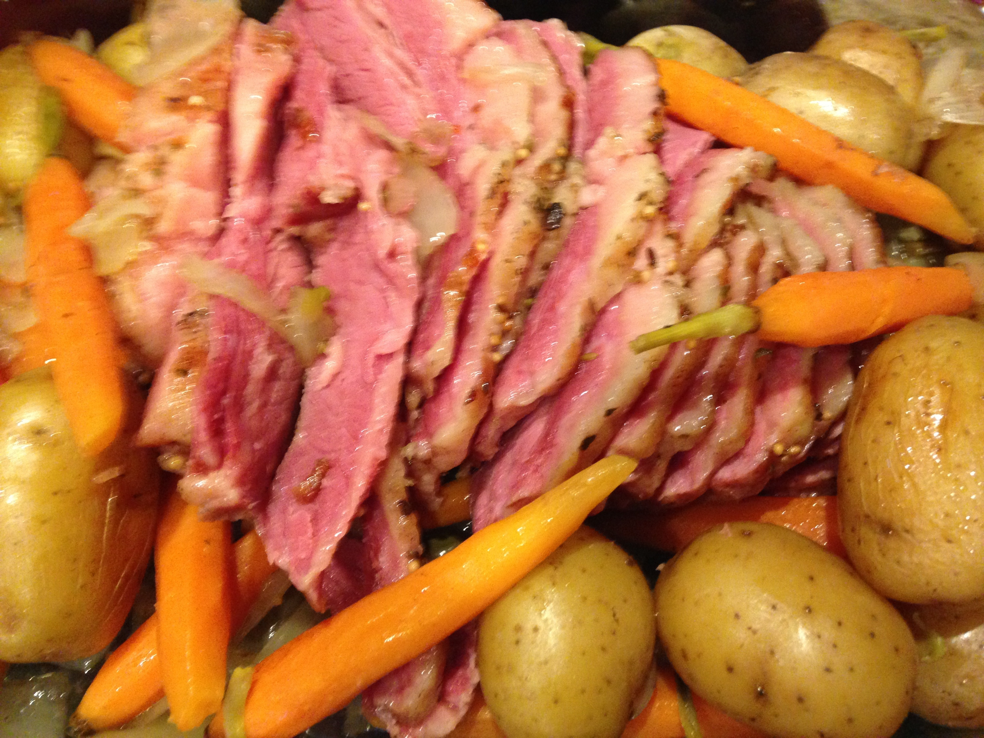 A Taste of St. Paddy's Day…Corned Beef, Potatoes, Carrots, and Roasted Cabbage on the side!