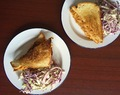 bbq pulled chicken and cabbage slaw sandwich