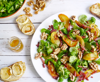 Autumn salad with pan seared apple slices, walnuts, bacon and grilled goat cheese bruschetta