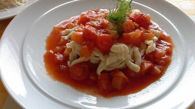 Homemade pasta with fennel and cherry tomato sauce