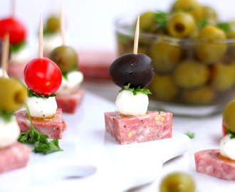 Herb-Marinated Mozzarella with Saummer Sausage and Olives