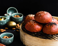 It comes in three's /-/ Beetroot baked char sui and shiikate mushroom buns