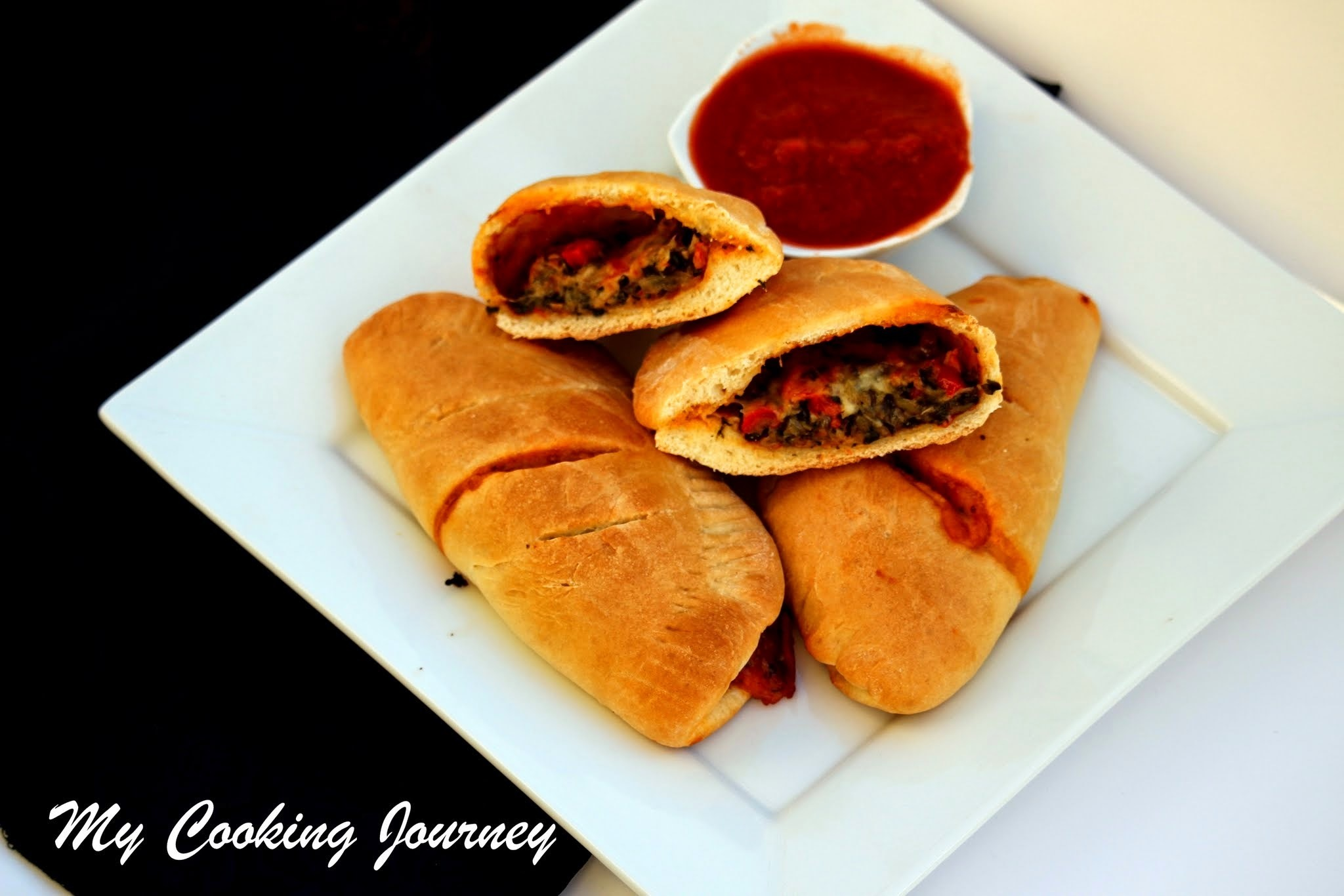 Vegetable Calzones – Calzone stuffed with Onions, Bell Pepper and Spinach