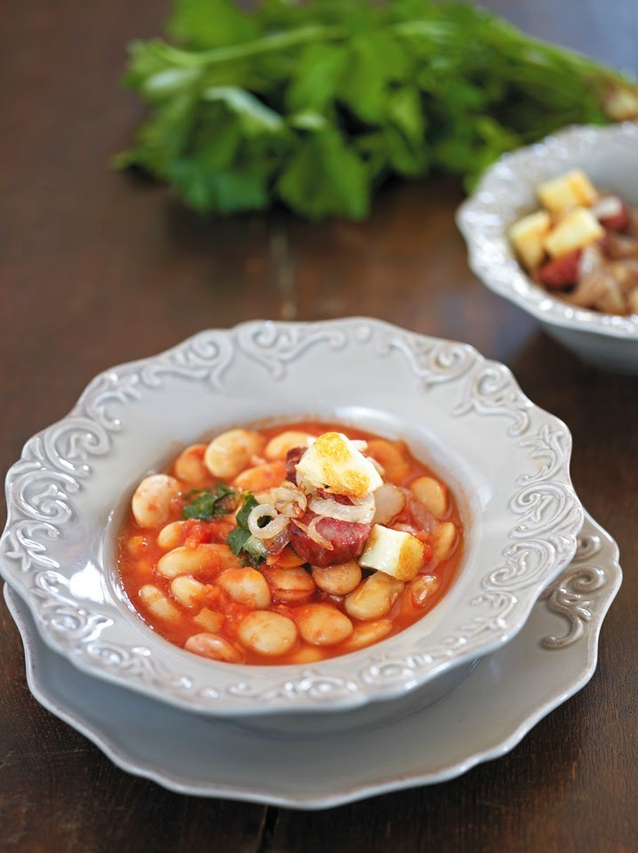 Spicy giant beans soup served with country-style sausages