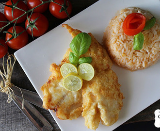 Filetes panados com arroz de tomate