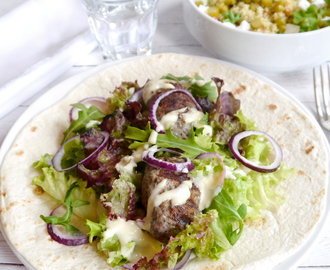 Grilled spring lamb koftas in a honey-lime-mayo dressing served with a green asparagus & feta tabouleh salad
