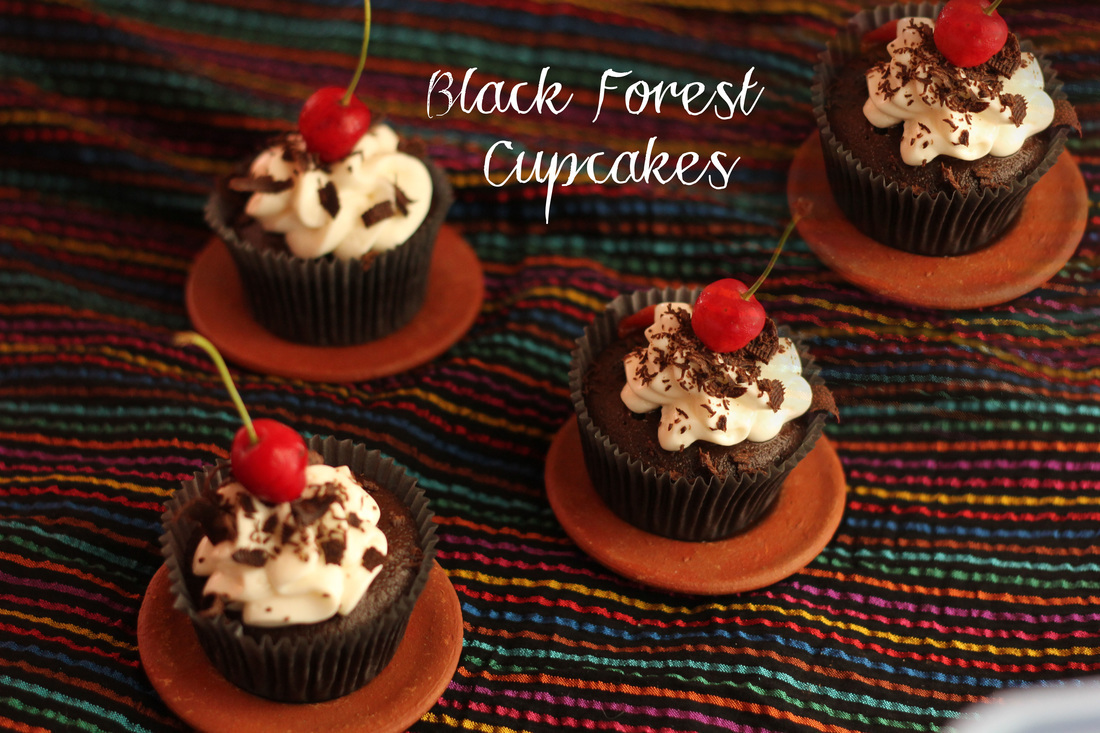 Black Forest Cupcakes: Chocolate Cupcakes with Cherry Kirsch Filling and a Whipped Cream Frosting
