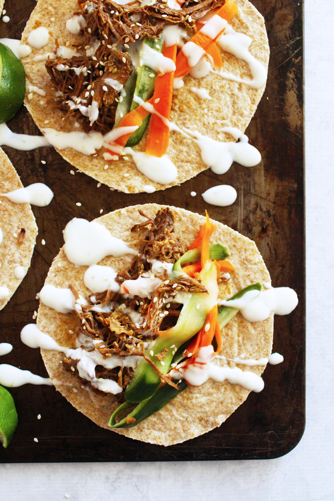 Slow Cooker Shredded Sesame Beef Tacos with Pickled Veggies and Lime Cream