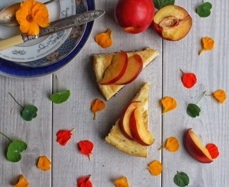 Summer season baked nectarine cheesecake with a biscuit and pink peppercorn base