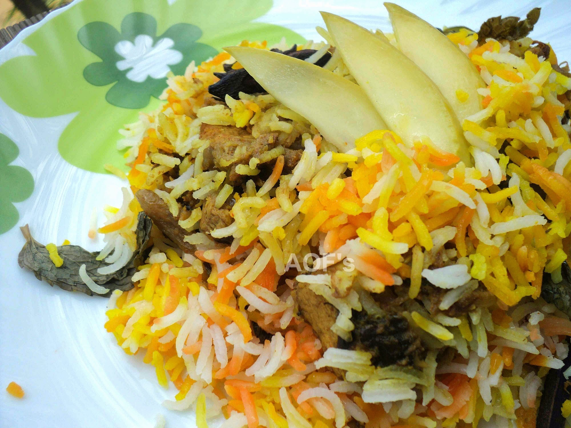Kairi ( Raw Mango ) Biriyani ( Chicken Biryani flavored with green mangoes )