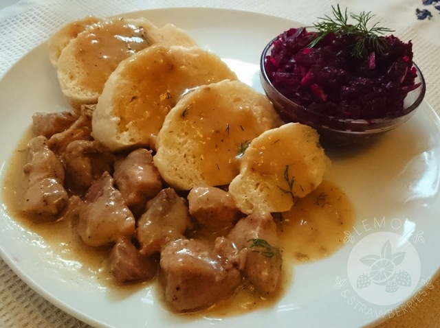 Polish steamed dumplings (Pampuchy) with pork stew and beetroot salad