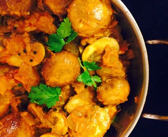 Mushroom Masala ( mushrooms cooked in spicy tangy onion-tomato sauce).