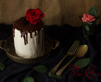 The Classic Black and White Cake: Chocolate Cake with White Chocolate Buttercream Frosting with Chocolate Drip and Chocolate Curls