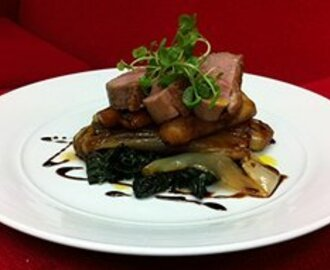 Duck breast with caramelised witlof, roast parsnip, spinach and sherry reduction