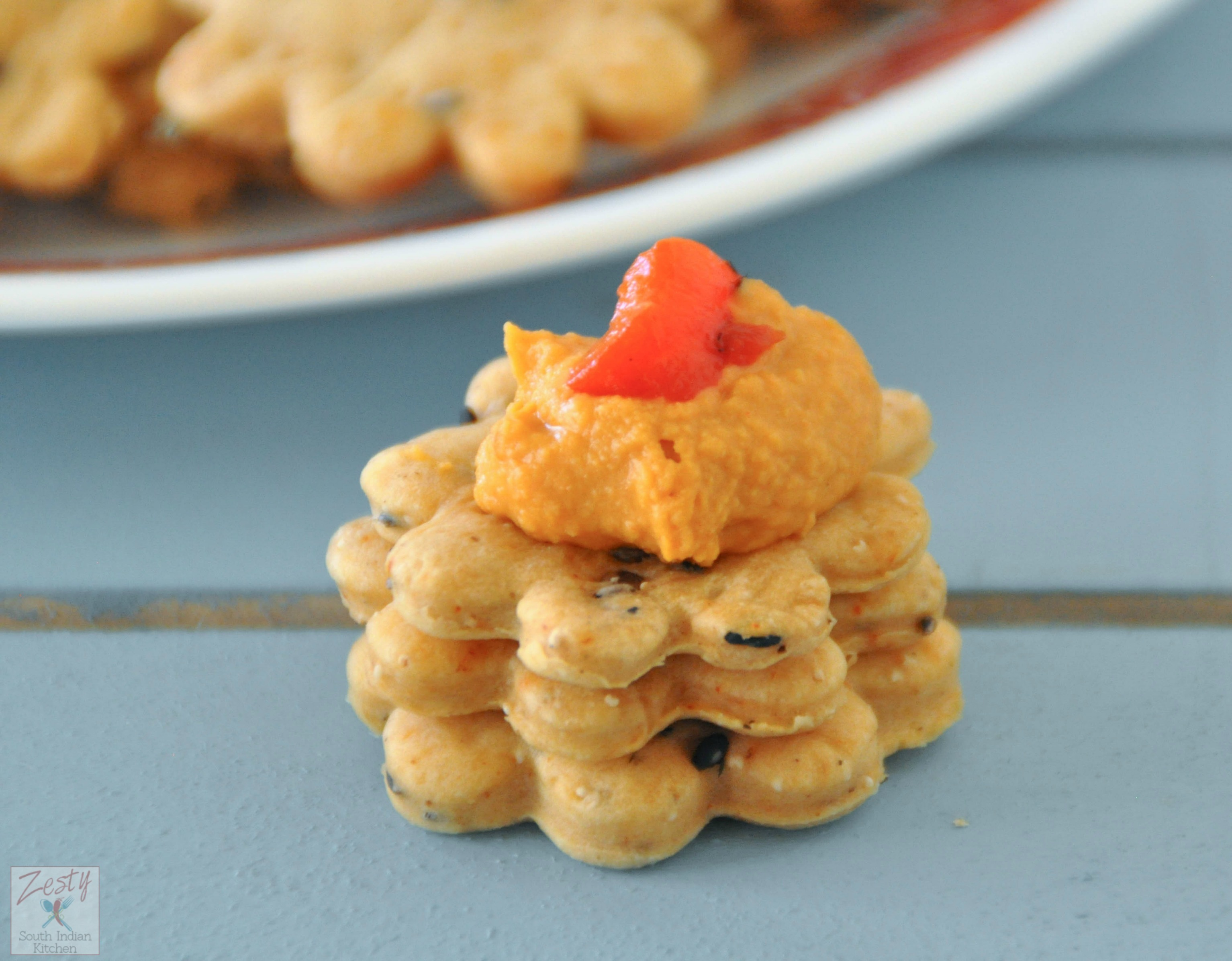 Chipotle olive oil crackers and roasted red pepper hummus
