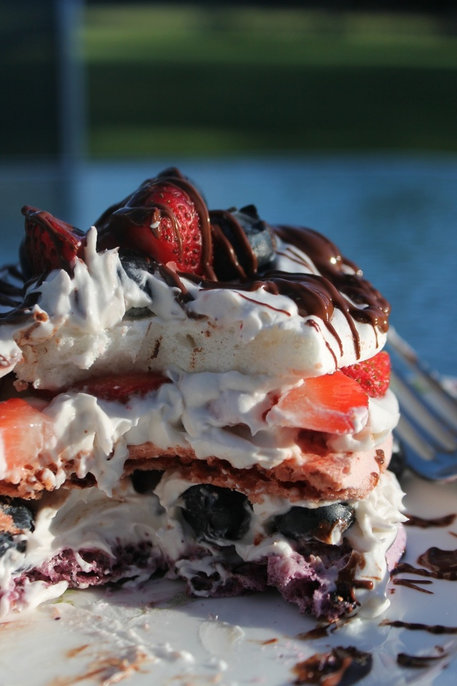 Red, White and Blue Meringue Cake with Coconut Cream and Fresh Berries