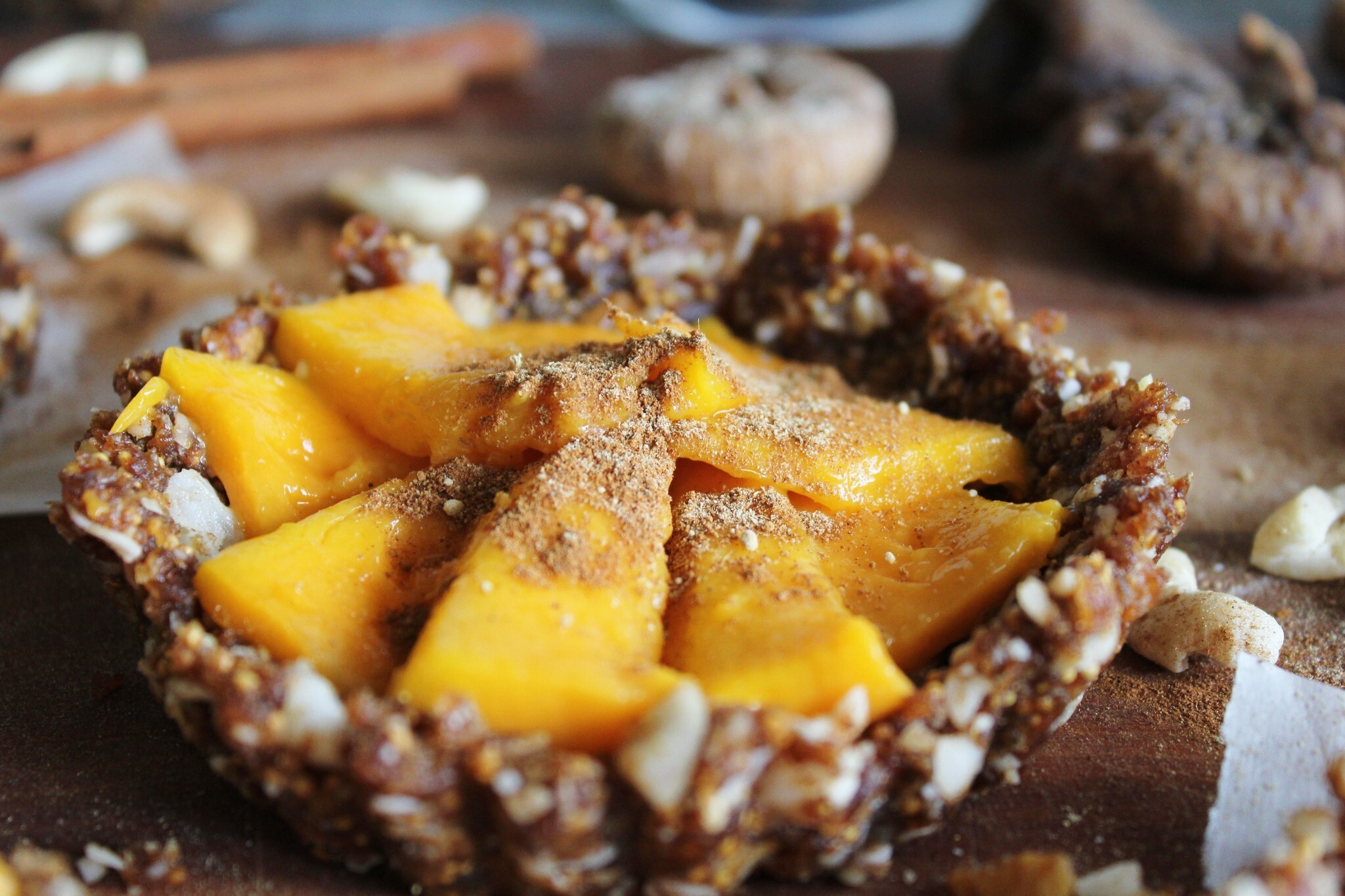 coconut mango tarts with figs, walnuts, cinnamon + ginger